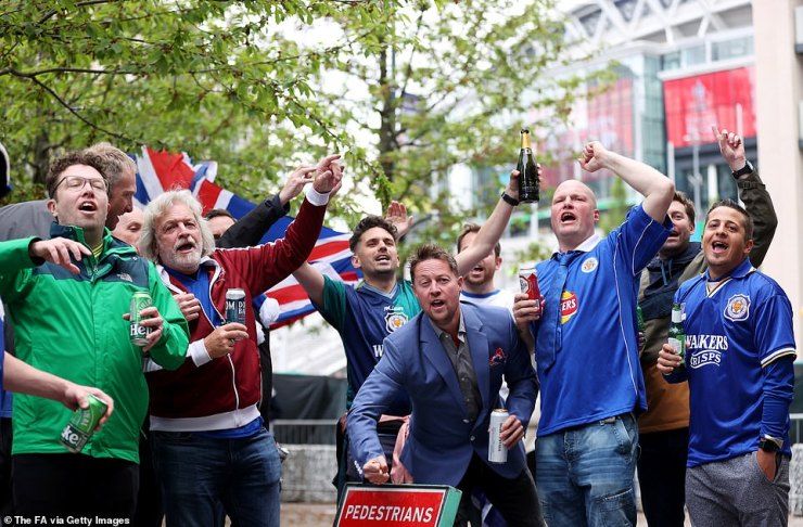Leicester City fans heading to the FA Cup final enjoy themselves outside Wembley Stadium on Saturday afternoon