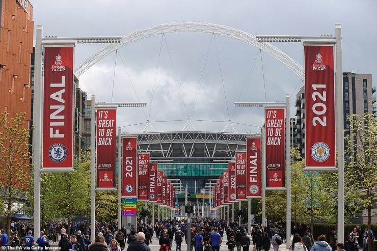 Supporters make their way along Wembley Way ahead of Saturday evening's FA Cup final between Chelsea and Leicester