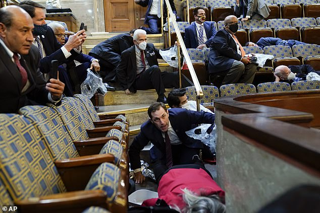 People take shelter in the home's gallery as rioters break into the Capitol living room on Jan.