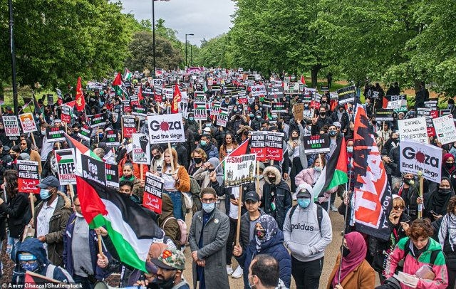 Thousands of people demonstrate through central London in a march organised by Stop the War