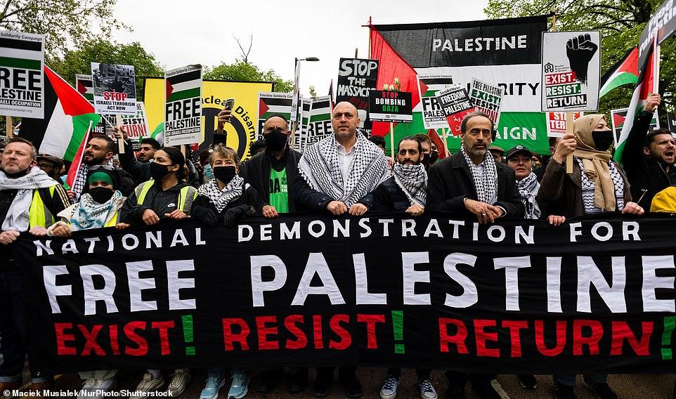 A large banner reading 'National Demonstration for Free Palestine. Exist! Resist! Return!' was held aloft