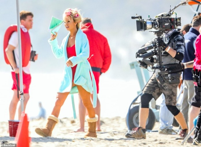 Expressing Opinions: James was seen wearing hair curlers and a blue terrycloth robe as she watched a scene in which Pam exchanges words with the Baywatch director between takes