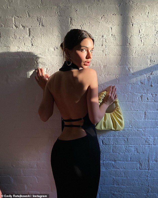 On Friday: Emily was on Instagram yet again, this time modeling a fabulous and sexy black halter gown