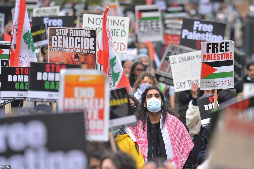 Demonstrators walk through Hyde Park as they make their way to the Israeli embassy in London, during a march in solidarity with the people of Palestine amid the ongoing conflict with Israel