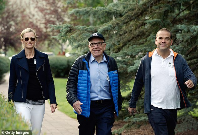 Rupert Murdoch (pictured center with his son Lachlan and Lachlan's wife Sarah) has afforded his family 'great privilege' from his wealth