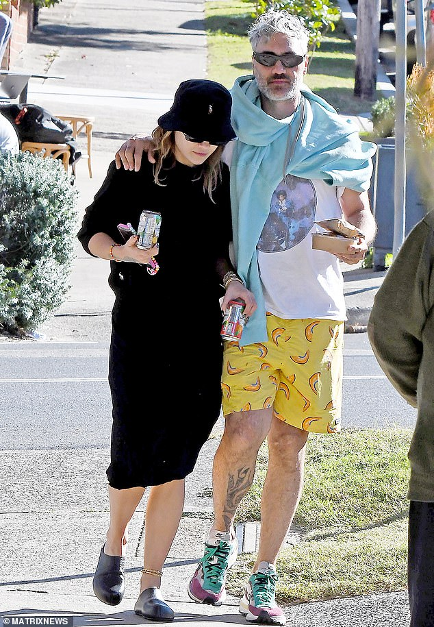 No hiding their love: Rita Ora [L] has been pictured for the first time with her new beau Taika Waititi [R], during a PDA-packed outing in Sydney