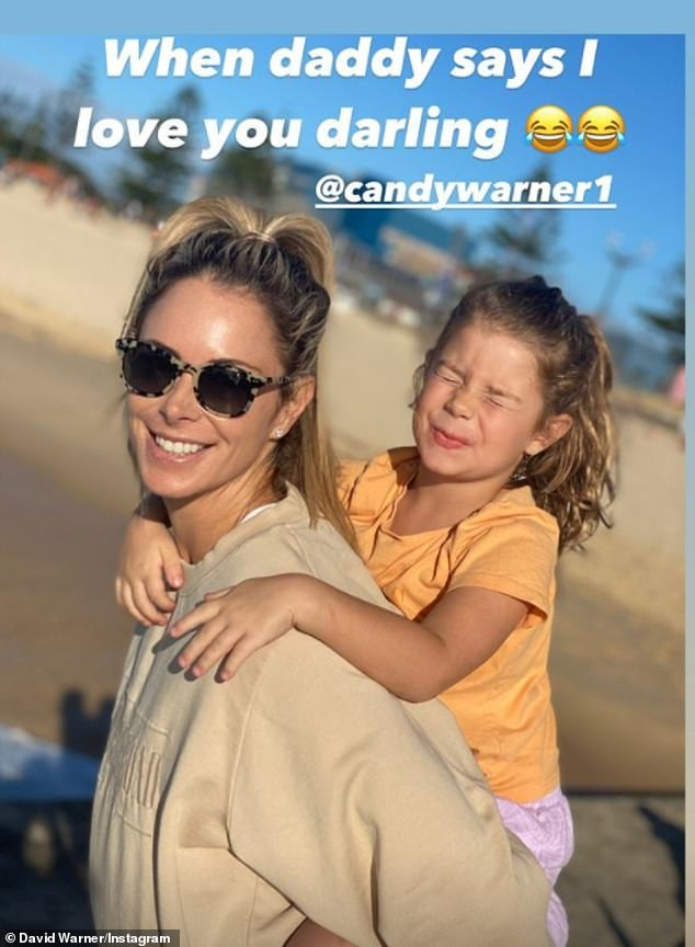 Family time: Another showed little Indi on mother Candice's back, with the youngster pulling a face to the camera.'When daddy says I love you darling,' he captioned the image