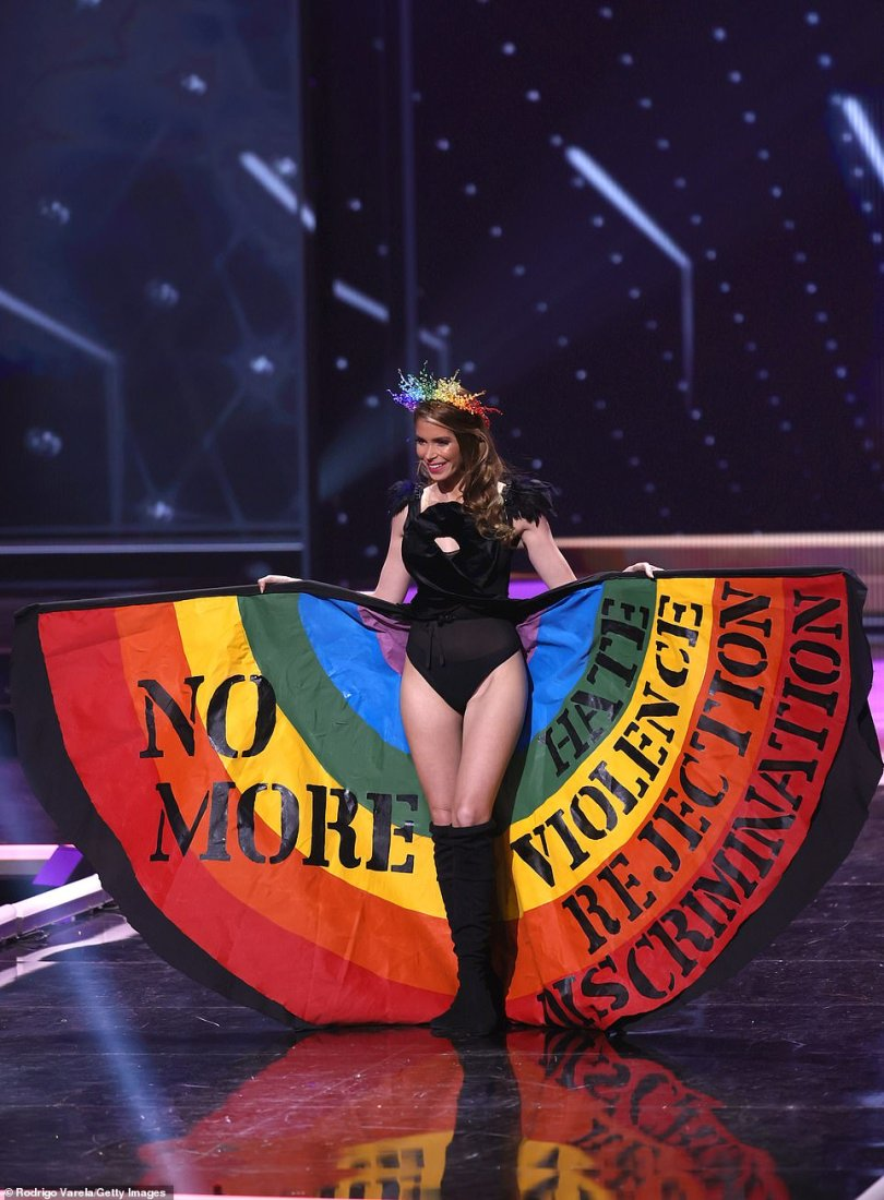 Also sending a message was Uruguay's Lola de los Santos Biccò, who fanned out her rainbow-colored cape to reveal the phrase: 'No more hate, violence, rejection, discrimination'