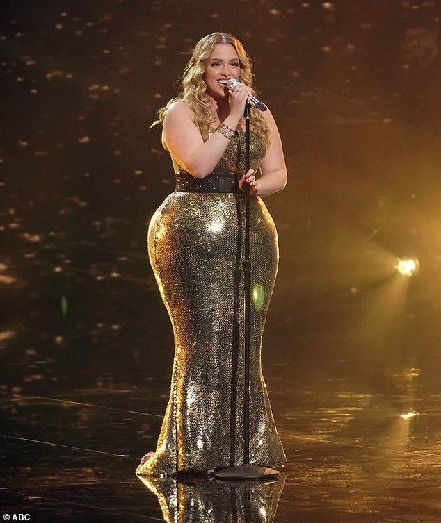 Stunner: The singer, 20, looked amazing as she took the stage to belt a cover of Kelly Clarkson's 2002 hit, A Moment Like This, while sporting a dazzling gold dress before slipping in later in a red dress worthy of Jessica Rabbit.