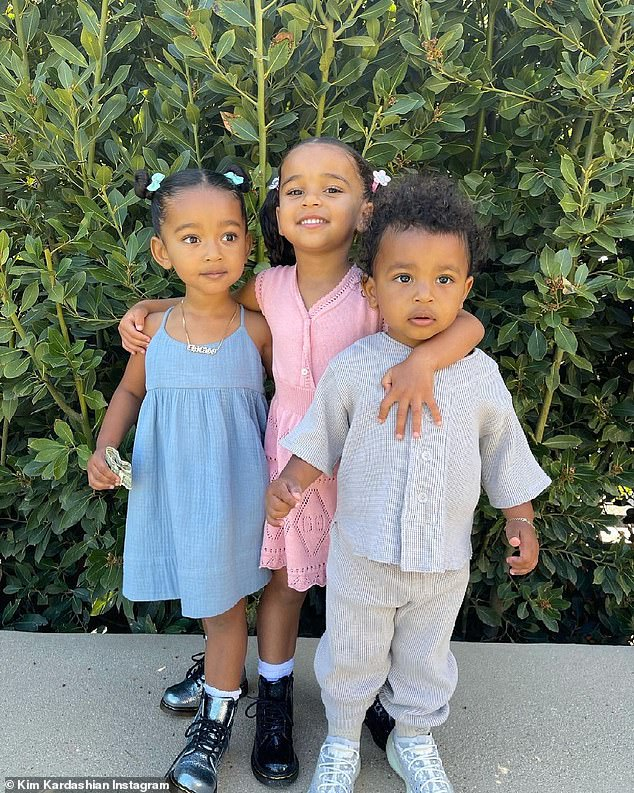 Cute threesome: The photo was of Dream with her arms around Chicago and Psalm.  Kim said in her caption: `` Sweet Sunday morning ''