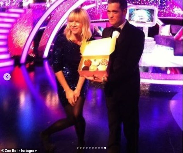 Throwback: Zoe also shared a snap of herself being presented with cupcakes by Michael Buble