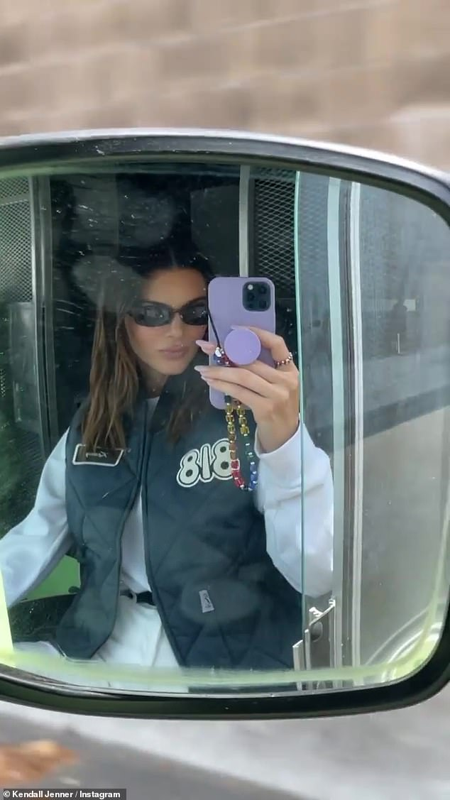 Ready to go: She looked comfortable behind the wheel as she posed for a few selfies while holding a lavender iPhone case
