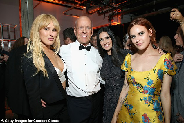 Famous family: Rumer is shown with father Bruce Willis, mother Demi Moore and sister Tallulah in July 2018 in Los Angeles