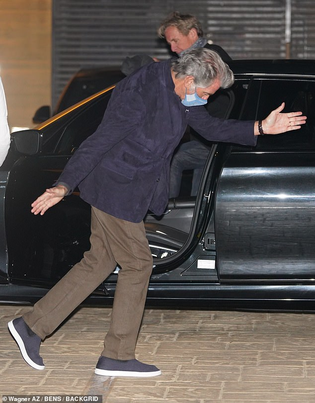 Joker: Pierce Brosnan put on a VERY lively display by swinging his arms dramatically as he headed for dinner with his son Dylan at Nobu on Monday