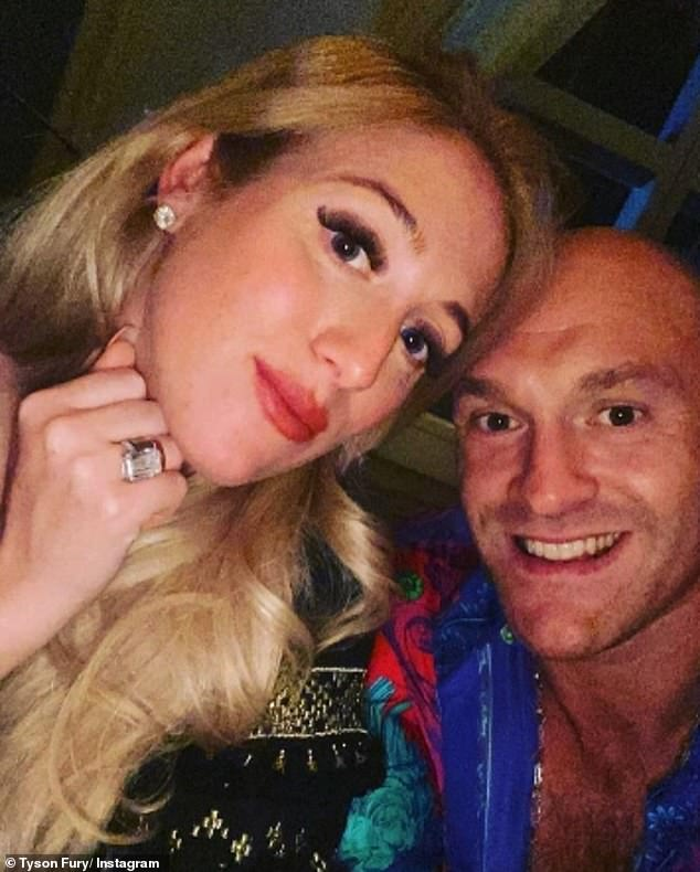 Making the point:Hours before Paris flashed her jaw-dropping diamond wedding ring as she posed for a selfie with Tyson - who is in America on a work trip - after reuniting