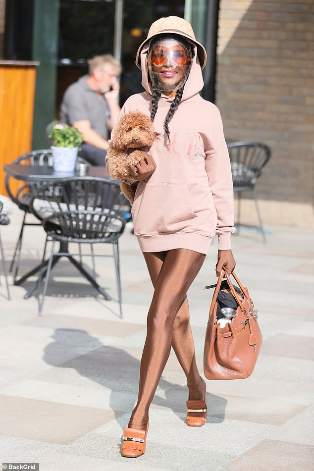 Working it: Sinitta carried her dog with her as she left the TV studios in her eye-catching outfit after the appearance
