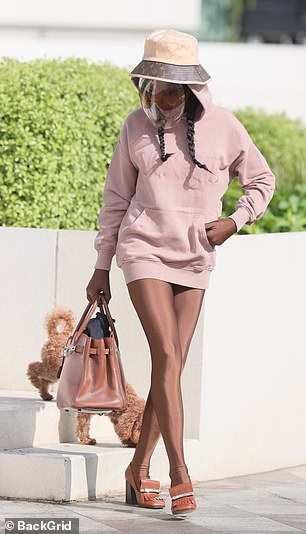 Strutting her stuff: She wore a nude hoodie over her leggings as she headed home