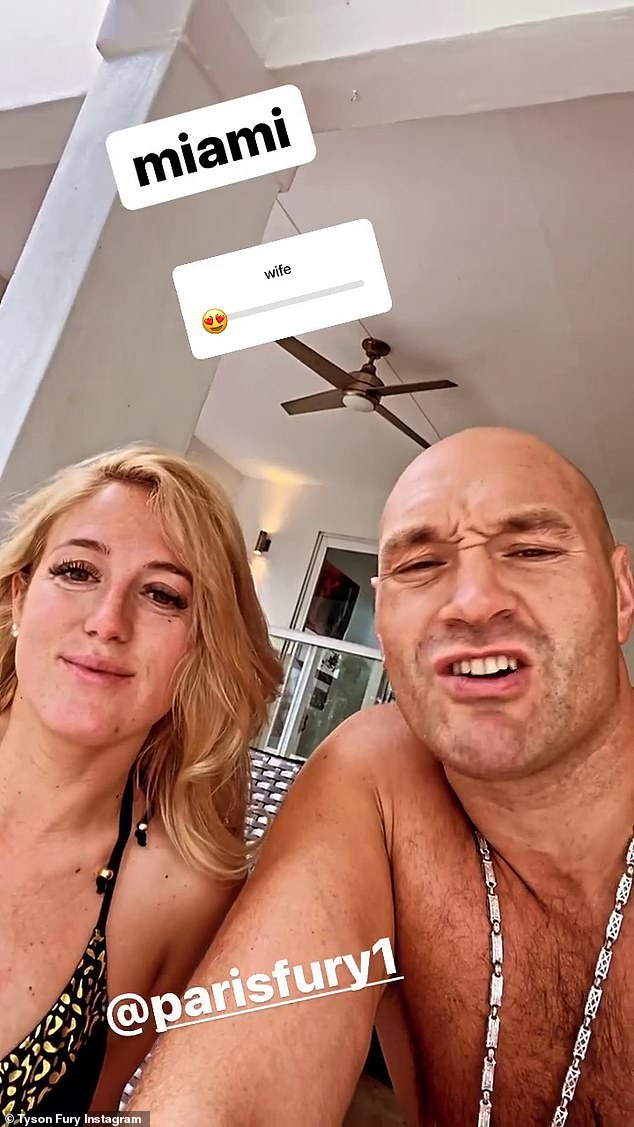 Living it up: Tyson took an Instagram video of the pair chilling out by the pool as they listened to music