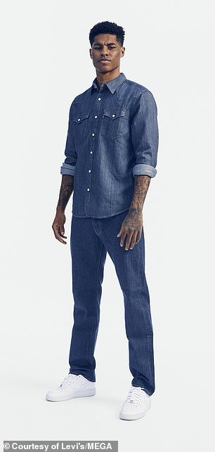 Dapper: Marcus sported a dark denim shirt for the shoot along with a pair of matching jeans