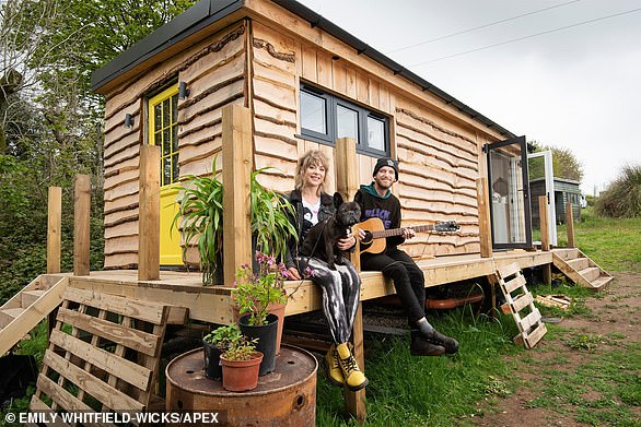 Off grid: Lizzy and Dan Brookes built a 'tiny home' from timber on the edge of their family-owned land in Cornwall