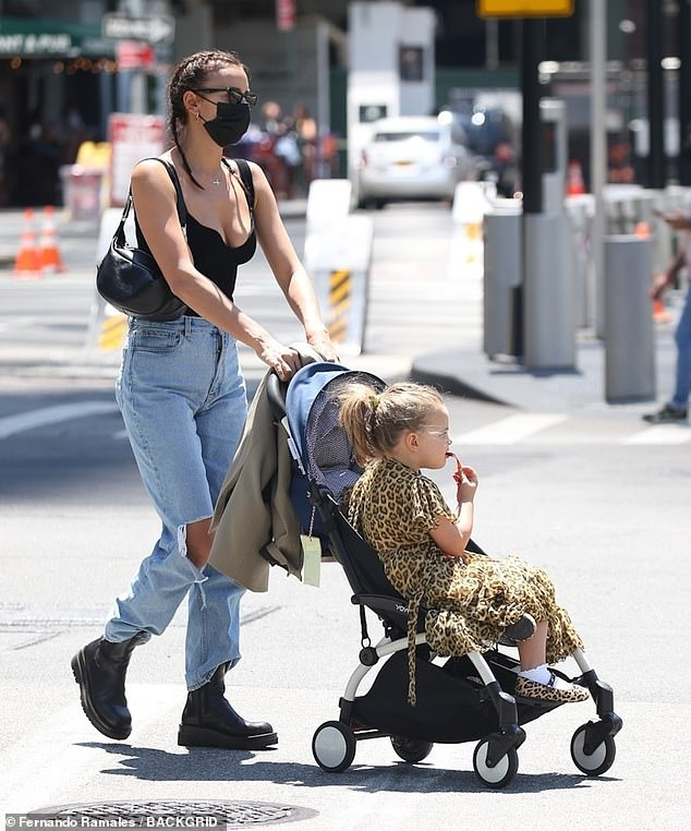 Chic in the city: The 35-year-old supermodel looked effortlessly cool in a tank top and ripped jeans while out and about in Manhattan