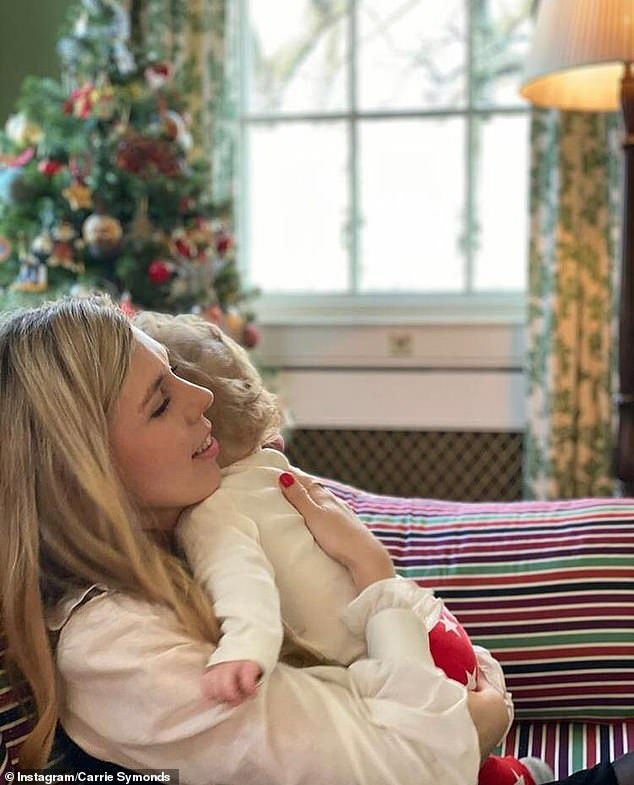 A photograph of Miss Symonds with Wilfred – her one-year-old son with Mr Johnson – was released by Downing Street at Christmas