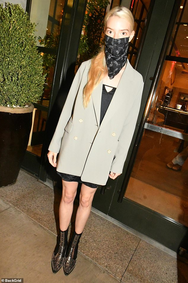 On the go: Anya was later seen leaving dinner in a gray double-breasted blazer over an LBD and studded leather boots