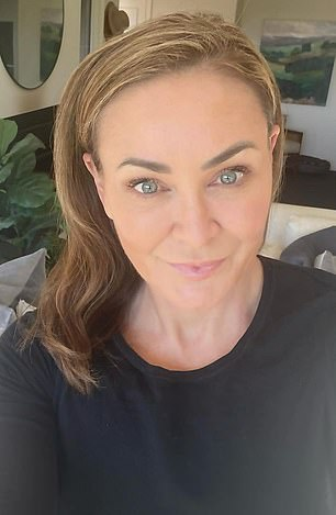 Take a walk on the lighter side!  Newly single Michelle Bridges debuted Tuesday with her new blonde hair.  In the photo after