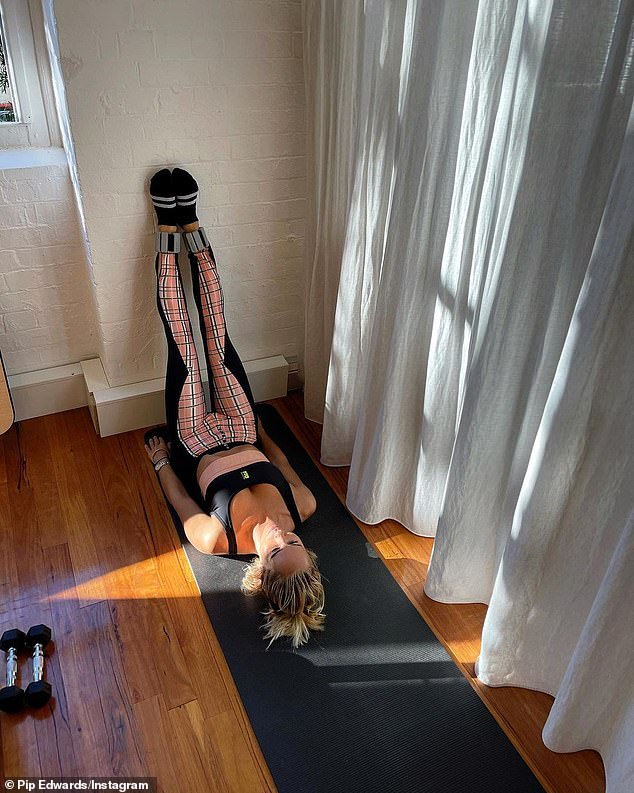 Self-care: P.E Nation founder, 41, shared a photo to Instagram on Tuesday of herself taking part in a relaxing Pilates exercise