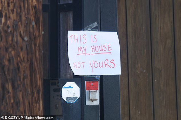 Get out:Hogan attached the note on his door before making his way back inside