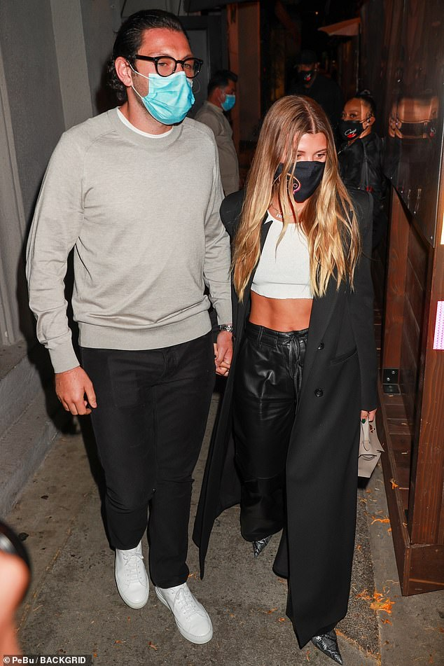 All eyes on her: Sofia flashed her enviably toned abs in a white crop top and statement leather flared trousers