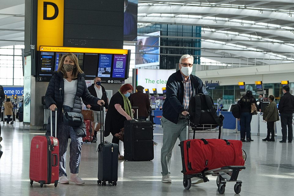 A couple head off on holiday from Heathrow Terminal 5 today amid confusion over travel to amber list nations