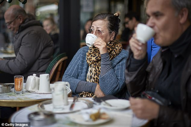 Parisians at Cafe de Flore embrace the lifting of Covid-19 restrictions as Cafes and Restaurants across France re-open for the first time in more than six months