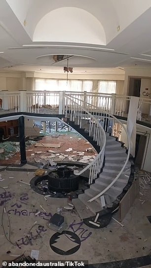 The curious teenagers found a destroyed staircase inside the multimillion-dollar home (pictured)