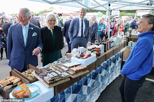The couple enjoyed themselves as they spoke to stall holders in the open air market