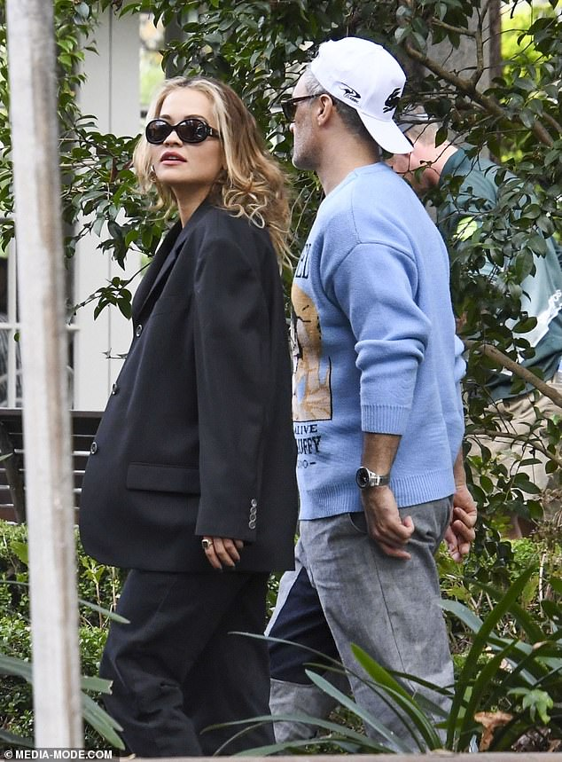 Accessories: Rita concealed her gaze behind trendy narrow-frame sunglasses, and styled her caramel locks out and wavy