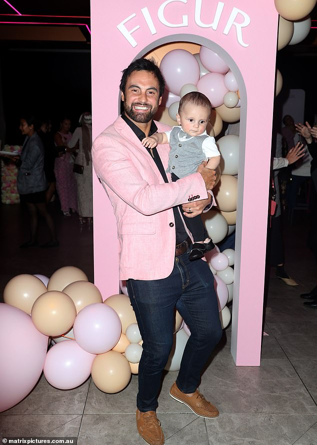 Casual cool:He paired the blazer with a black shirt along with a pair of denim jeans. Cam nursed son Oliver during the event