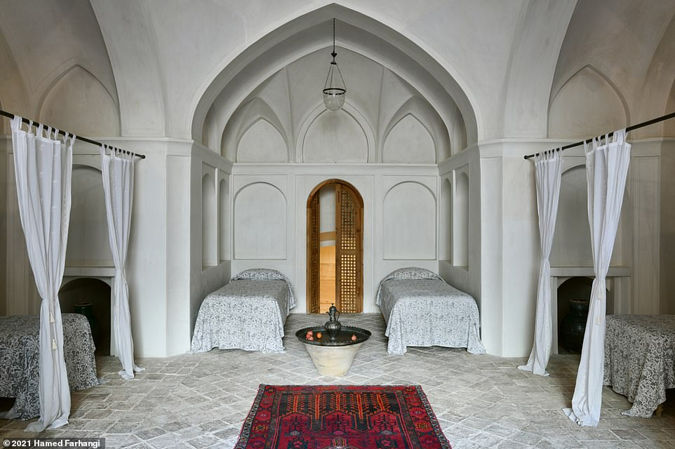 This high-ceiling room is the largest of 20 available at Manouchehri House. It sleeps up to six people and is decorated with antique Iranian furnishings and intricate carpets. Wegmann writes: 'Hidden away by its exterior walls, the hotel has a real sense of tranquility enjoyed by guests, who are often in search of this exact peace of mind'