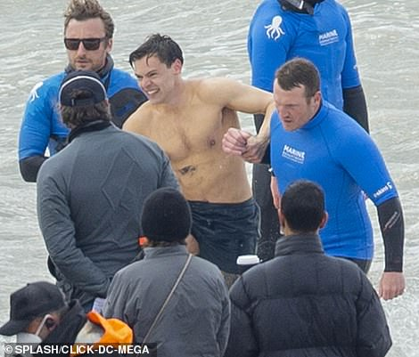 Looking good! The former One Direction star could be seen plunging into the water to record the scenes on the Brighton coast