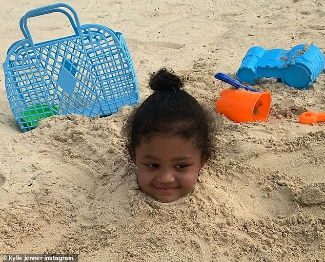 'I spy with my little eye':Kylie Jenner posted a heart-melting Instagram picture this Thursday of her trip to the beach with her daughter Stormi