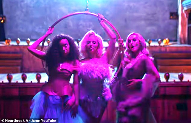 Blooming lovely:The pregnant singers joined Jade Thirwall, 28, in dressing as stunning winged angels in the burlesque-inspired video for their collaboration with David Guetta and Galantis