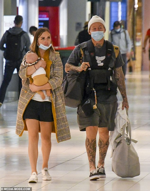 Baby on board! Susie Bradley and Todd Carney jetted into Sydney on Wednesday with their baby son Lion