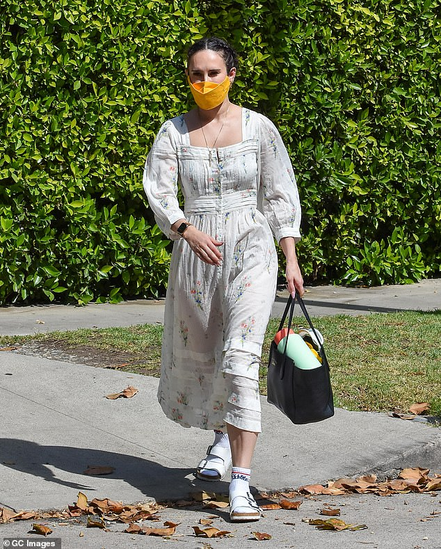 Socks and sandals? Rumer Willis managed to pull off a fashion faux pas as she stepped out to run some errands in LA on Friday, wearing a summery dress with the choice footwear