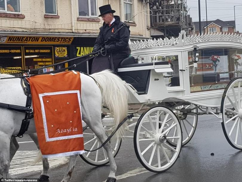For Azaylia: In a symbolic reference to Azaylia's nickname 'likkle lion', four white horses wore orange feathers and covers in a touching tribute to her courageous battle