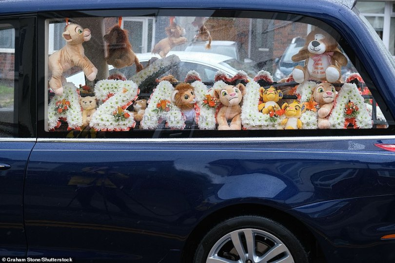 Heartbreaking: Lion King stuff toys and a floral tribute of her name were displayed in a hearse