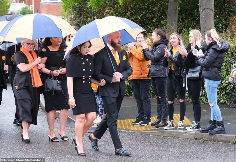 Supportive:A grieving Ashley, 30, wiped away tears as he became overwhelmed with the emotion as the cortège began, with the crowd showing their love to the couple and Azaylia by clapping and cheering during the 15-minute journey