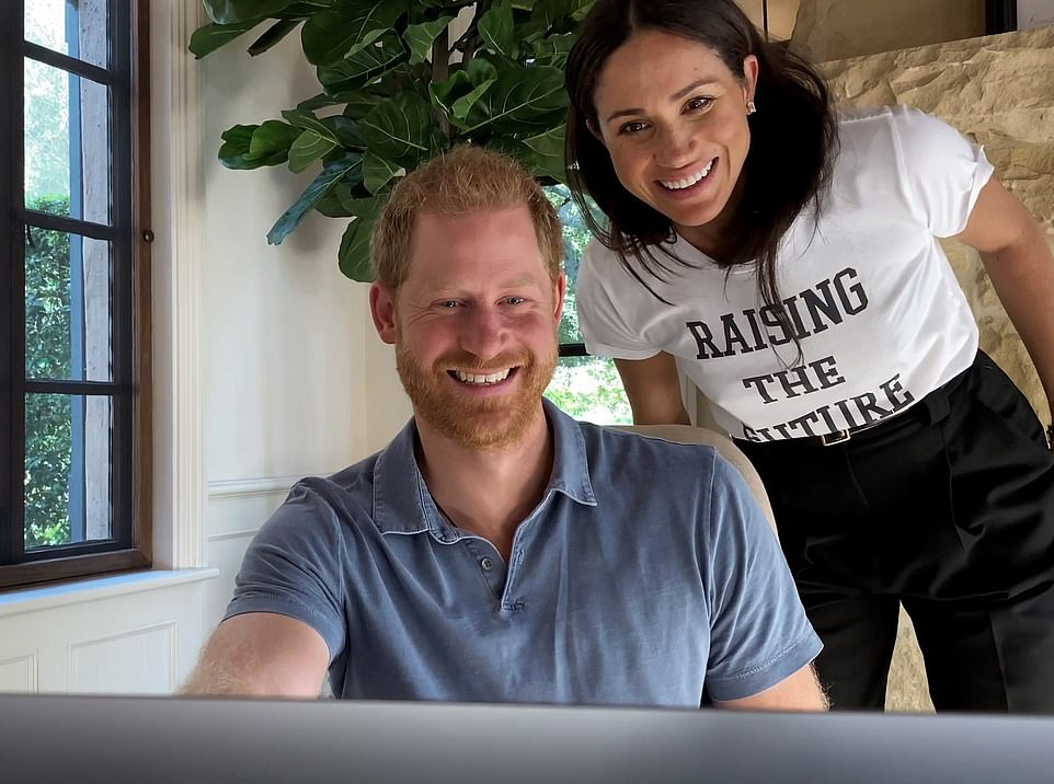 Meghan also appeared in one scene, standing behind Harry who is sat at a computer. It is the same spot where the couple sat to take part in a video call for the Queen's Commonwealth Trust, in front of a huge stone fireplace