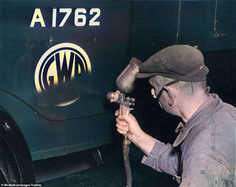 In this picture taken at Paddington in 1948,the logo on a road wagon of private rail firm Great Western Railway (GWR) is spray-painted