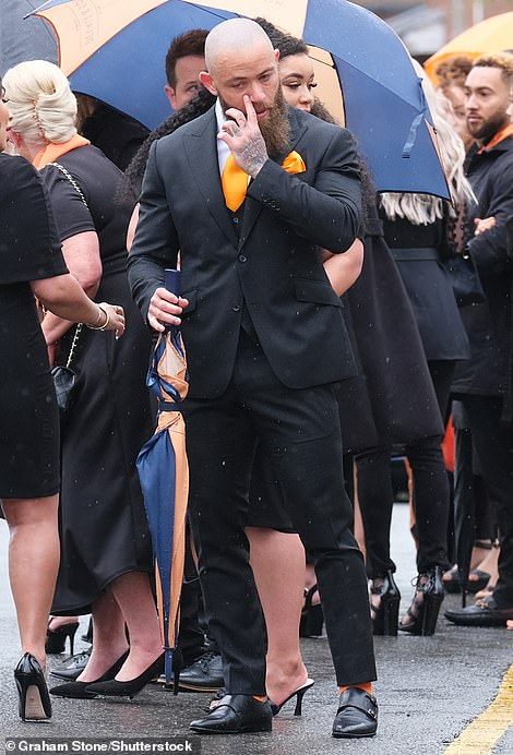 Always in our hearts: Ashley Cain and his partner Safiyya broke down in tears as they watched the funeral procession for their baby daughter Azaylia, who tragically died last month