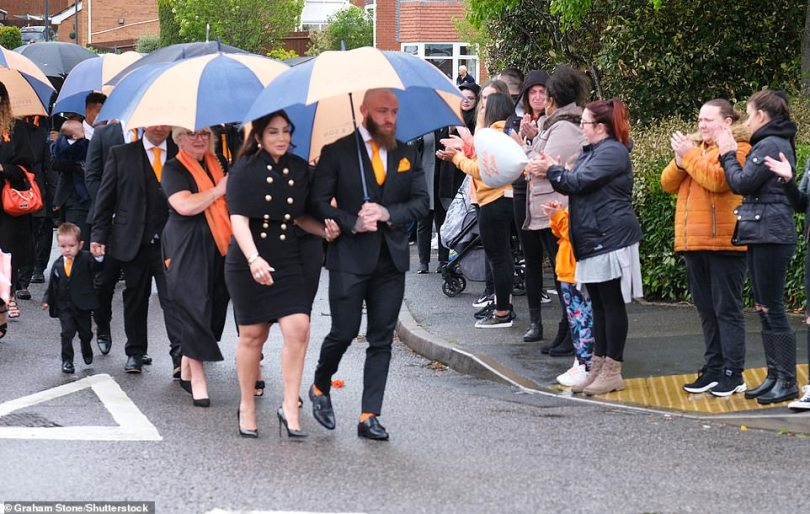 Clapping for Azaylia: The couple had encouraged well wishers to line the streets of Nuneaton for Azaylia's cortège after sharing the planned route for the 15 minute journey